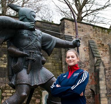 Trampoline and Tumble athlete Bryony Page next to Nottingham's famous Robin Hood statue