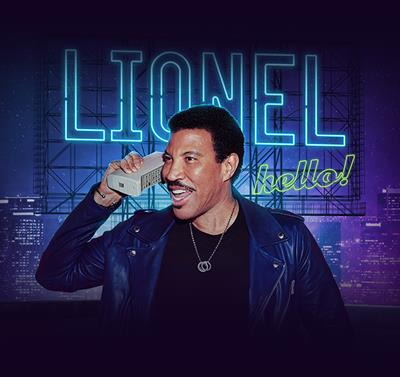 "Official Lionel Richie concert artwork, consisting of Lionel using a retro phone in front of a neon sign that says ""LIONEL hello!"""